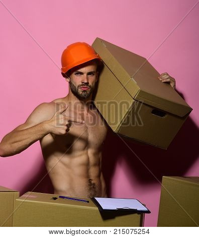 Man With Beard Stands Naked On Pink Background.