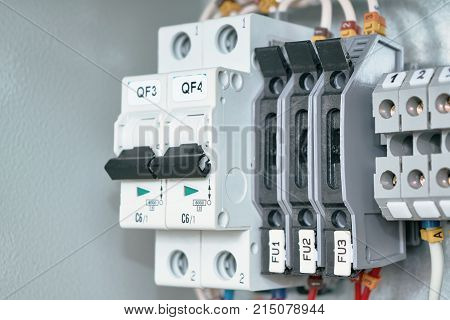Electrical Cabinet with circuit breakers terminals with breakers and bushing terminals. To the switches and terminals connected to electric wires marked. Circuit breakers provide reliable protection.
