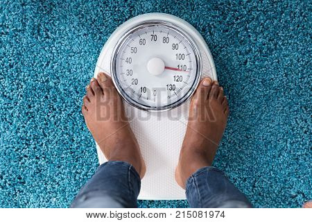 High Angle View Of A Human Foot On Weighing Scale