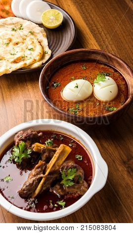 Anda Curry or Egg Curry or Egg masala gravy, indian spicy food or recipe, served with roti or naan, selective focus