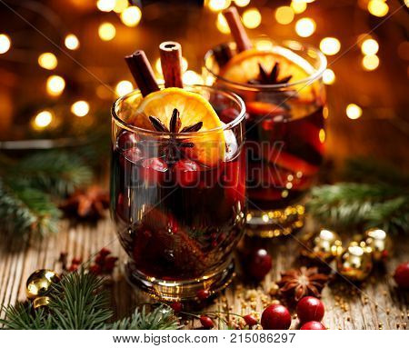 Mulled red wine with addition of citrus fruits, cranberries, cinnamon sticks, cloves and anise stars. Delicious christmas hot drink