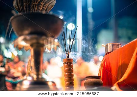 Horizontal picture of burning candle at religious Ganga Aarti ritual at Dashashwamedh Ghat in Varanasi India.