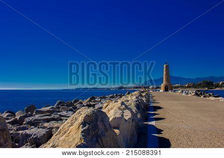 Lighthouse. Port of Puerto Banus, Marbella, Costa del Sol, Andalusia, Spain.