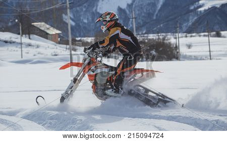 Snowbike Snowmobilw Journey extreme trip with dirtbike in the mountain adn blue sky