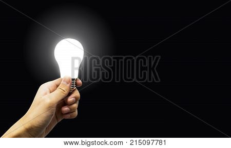 Concept Brightness in the dark. Good solution. hand holding glowing polygonal lamp on background back. Innovative ideas concept. Bright idea. the way to solve problem. Creative thinking Bright Ideas for Business Finance Solutions.