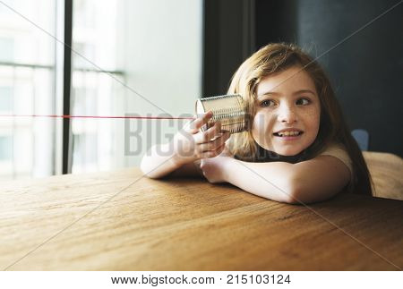 Little girl playing with a thin cna