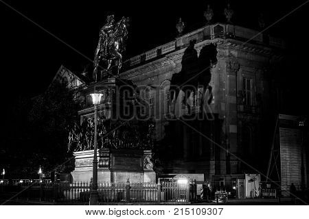 BERLIN - OCTOBER 08 2017: Equestrian statue of Frederick the Great on Unter den Linden in the evening illumination. Black and white.