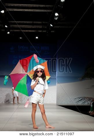VALENCIA, SPAIN - JULY 1: An unidentified child model on the runway at the FIMI Children's Summer Fashion Show for designer Camina in the Feria Valencia on July 1, 2011 in Valencia, Spain.