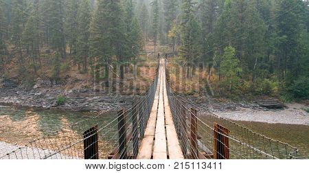 Suspension Plank And Wire Bridge Over The Flathead River At The Spotted Bear Ranger Station / Campgr
