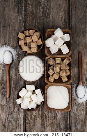 Six Bowls Of Sugar  And Two Wooden Spoons