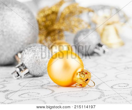 golden christmas decoration balls on white background