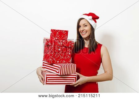 Beautiful Caucasian Young Happy Woman With Charming Smile Dressed In Red Dress And Christmas Hat Hol