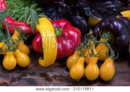 Red And Purple Sweet Pepper And Yellow Tomatoes