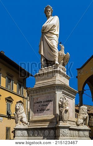 FLORENCE, ITALY - AUGUST 8, 2017: Monument to Dante Alighieri in front of the of the Santa Croce Basilica. The statue was erected in 1865 to celebrate the 600 anniversary of the birth of the poet.