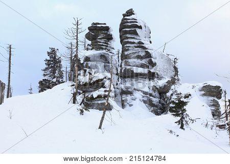 Winter landscape with rock in Sumava Czech republic