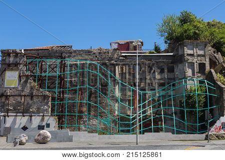 Oporto, Portugal - july 2016: Wrecked Buildings and Walls with Green Artistic Trestle in Porto Portugal.
