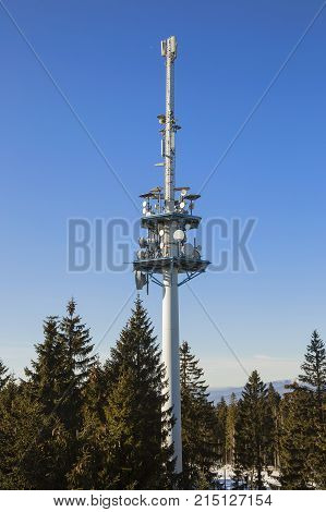telecommunications tower in sunny day on blue sky