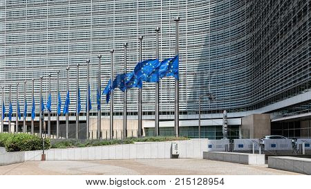 BRUSSELS - JUNE 17, 2017: Half-mast flags in front of the Berlaymont office building - seat of the headquarters of the European Commission the executive of the European Union.