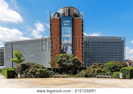 BRUSSELS - JUNE 17, 2017: The Berlaymont building viewed out of the Schuman Roundabout. The Berlamyont is a seat of the headquarters of the European Commission the executive of the European Union.