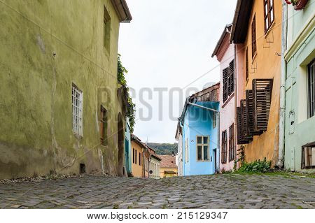 Sighisoara, Romania, October 08, 2017 : Quiet street leaving the Fortress Square in the castle of old city. Sighisoara city in Romania