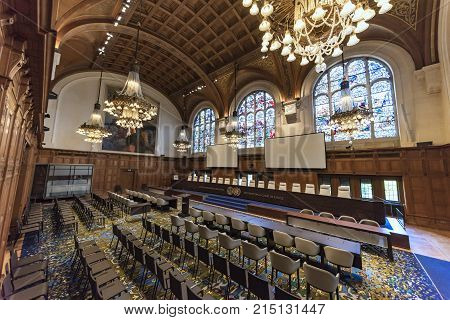 THE HAGUE 11 August 2017 center view of the empty international court of justice great hall of justice courtroom with judges bench lawyers and audience chair settings before holding a hearing