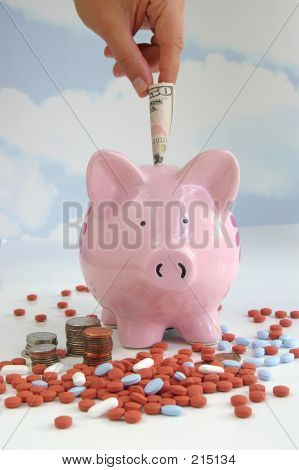 Hand Putting Money In Piggy Bank 2