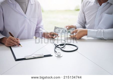 Doctor received corruption money from businessman form of dollar banknotes Bribery and corruption in Health Care Industry.
