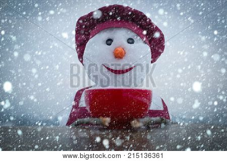 Snowman Chef In Winter With Kitchen Plate