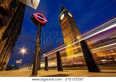 LONDON, UK - MAY 2, 2014: London underground symbol under Big Ben. Big Ben is London most famous symbol.
