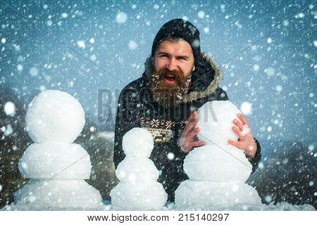 Snowman Family Made Of White Snow