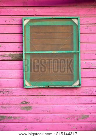 Mahahual Caribbean grunge pink wood painted wall in Costa Maya Mexico
