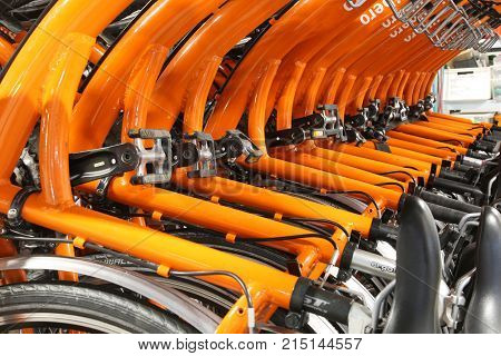 Vicenza, Vi, Italy - January 1, 2017: Warehouse Of Orange Bicycles For Eco-sustainable Tourism In Th