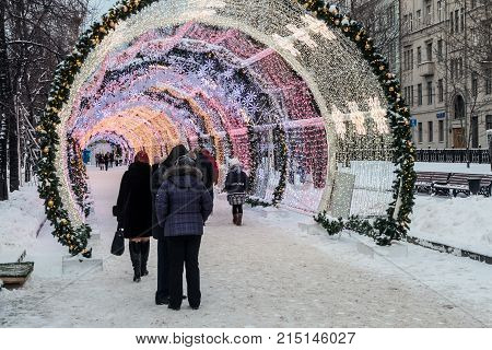 MOSCOW, RUSSIA - January 14, 2016: People and tourists walk along Moscow decorated for New Year and Christmas holidays. Christmas village fair on Tverskaya street in the Moscow
