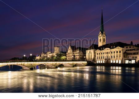 View of historic Zurich city center with famous Fraumunster Church and river Limmat at Lake Zurich in twilight Canton of Zurich Switzerland.