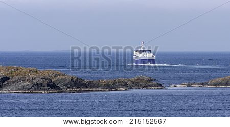 NORTH SEA, NORWAY ON JULY 04. View of the regularly transport, ferry from Haugesund to Utsira on July 04, 2010 in the North Sea, Norway. Cliffs and the Atlantic. Editorial use.