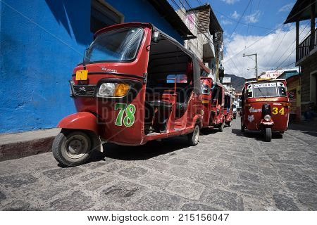 April 6,2016, San Pedro la Laguna,Guatemala: tuktuks lining up waiting for customers beside the local market very popular as a low budget transportation