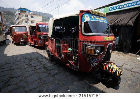 April 6,2016, San Pedro la Laguna,Guatemala: three wheeled tuktuks are very popular as a low budget transportation