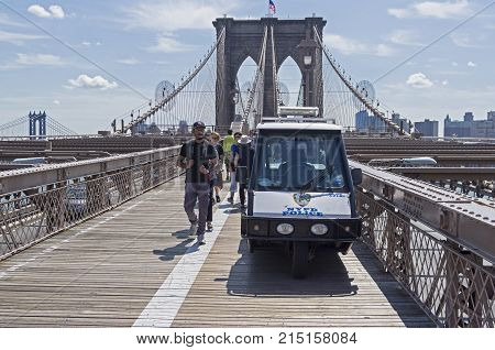 A Small Police Electric Car On The Footpath Of The Brooklyn Bridge.