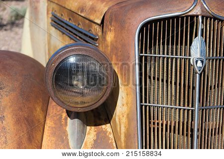 November 9, 2015 Nelson, Nevada, USA: front end closeup of a vintage abandoned rusty classic car