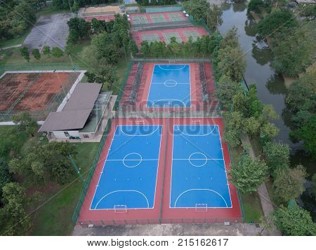 football tennis basketball pitch concrete in the park drone top view