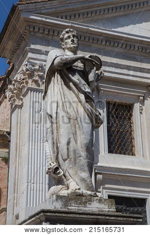 Statue on the façade of the Cathedral of Urbino