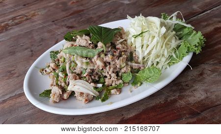 spicy laab thai pork salad with fresh vegetable