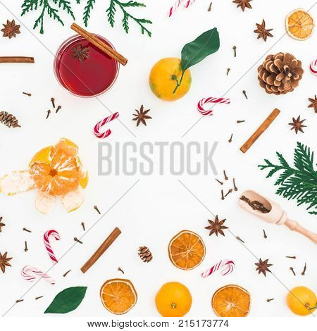 Christmas hot mulled wine with cinnamon, anise and candy cane on white background. Flat lay, top view