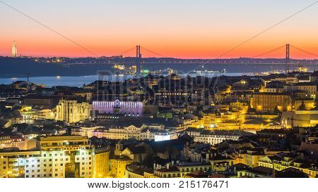 LISBON PORTUGAL - NOVEMBER 19 2017: The cityscape of Lisbon Portugal by night shortly after sunset on a November day.