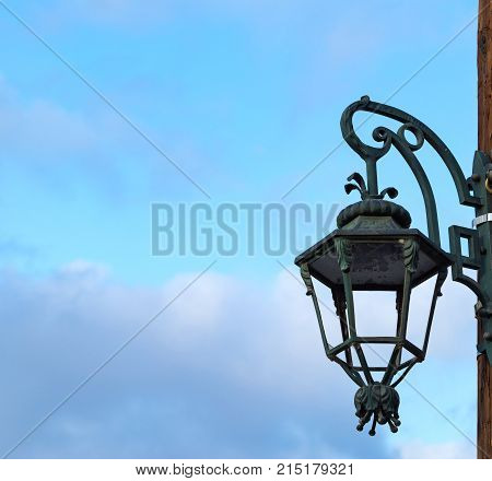 one old ancient lamp or lantern for a streetlight closeup against the background of the sky