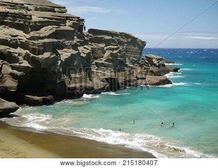sunny day at Papakolea Green Sand beach on Big Island, Hawaii