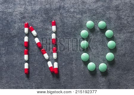 The word No made out of colorful pills. Medicine and healthy. Different kind of pills.