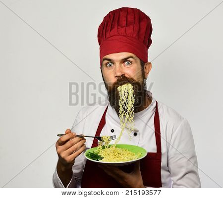 Man With Beard Holds Tasty Dish On White Background