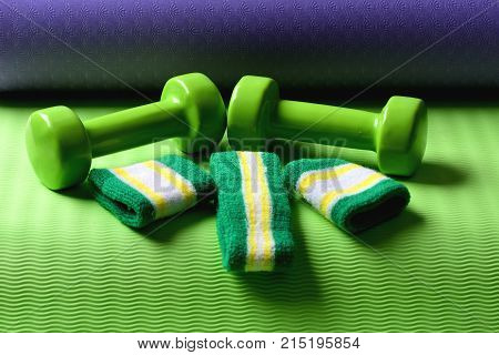 Shaping And Fitness Equipment. Dumbbells Made Of Green Plastic