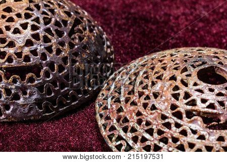 Two silver hemispheres golden look in jewelry making process